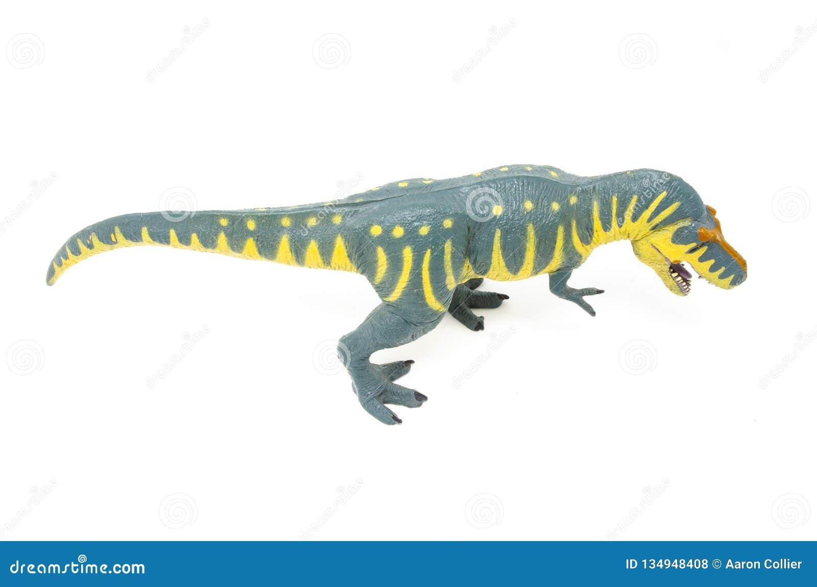 Пластиковая желтая голубая игрушка динозавра Rex тиранозавра над верхней частью