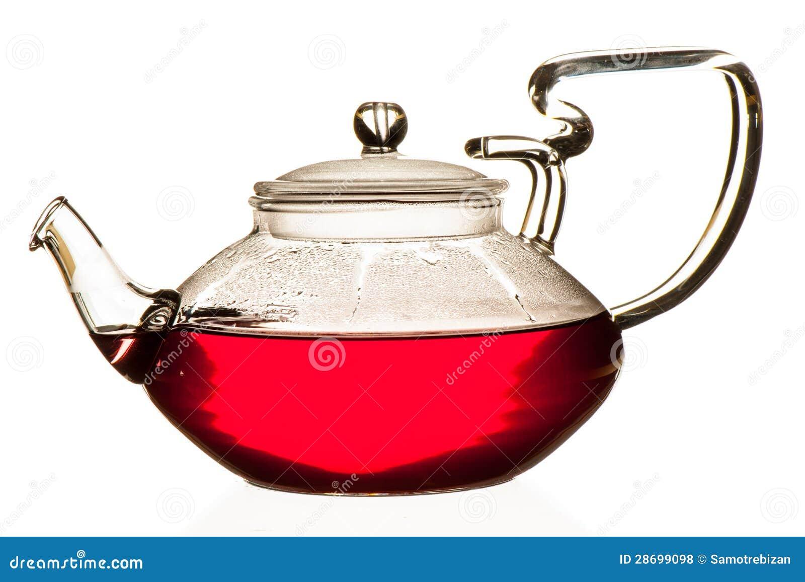 Плодоовощи чая пущи в стеклянном чайнике изолированном над белым bac