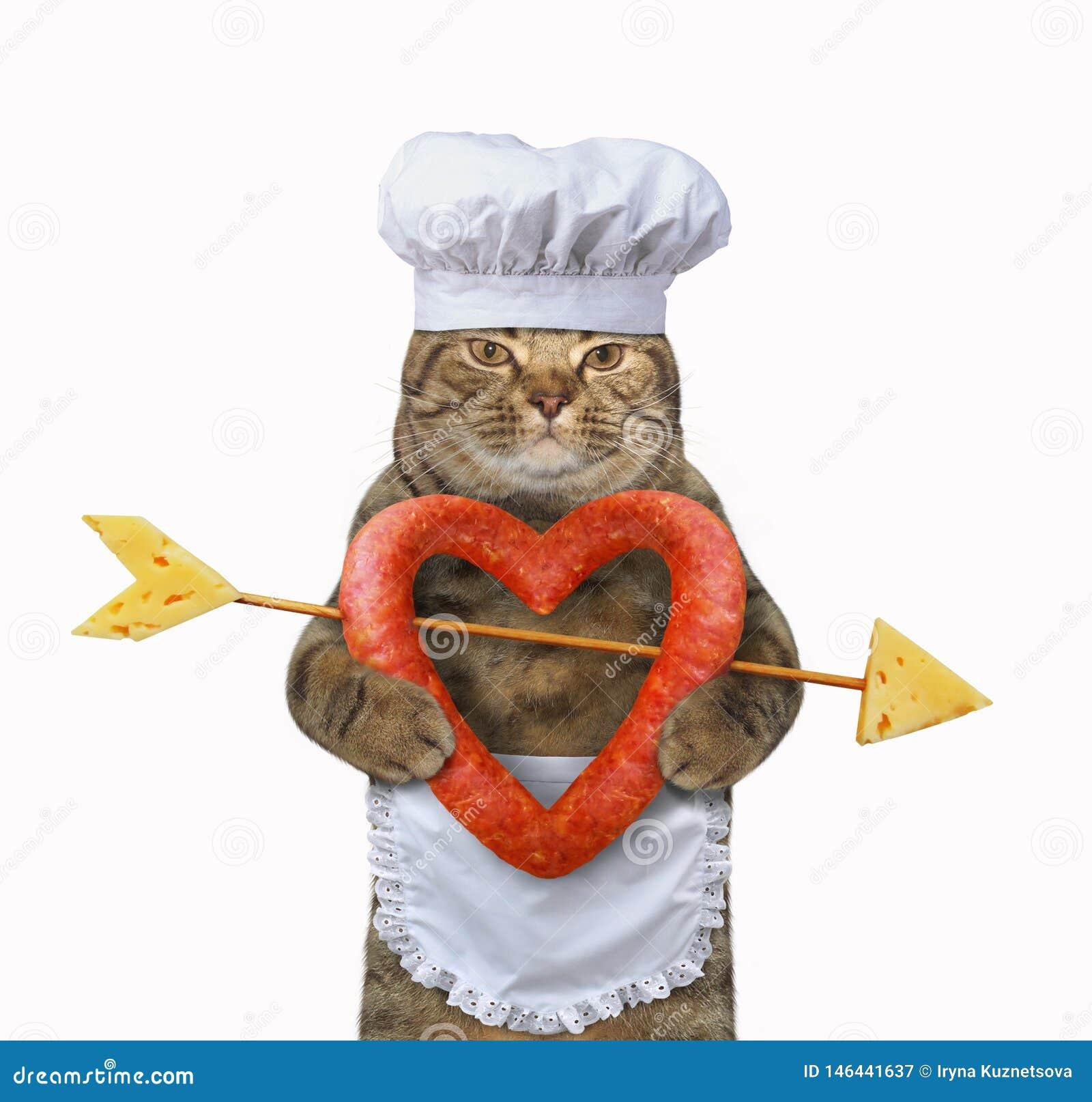 Повар кота держит сосиску сердца форменную