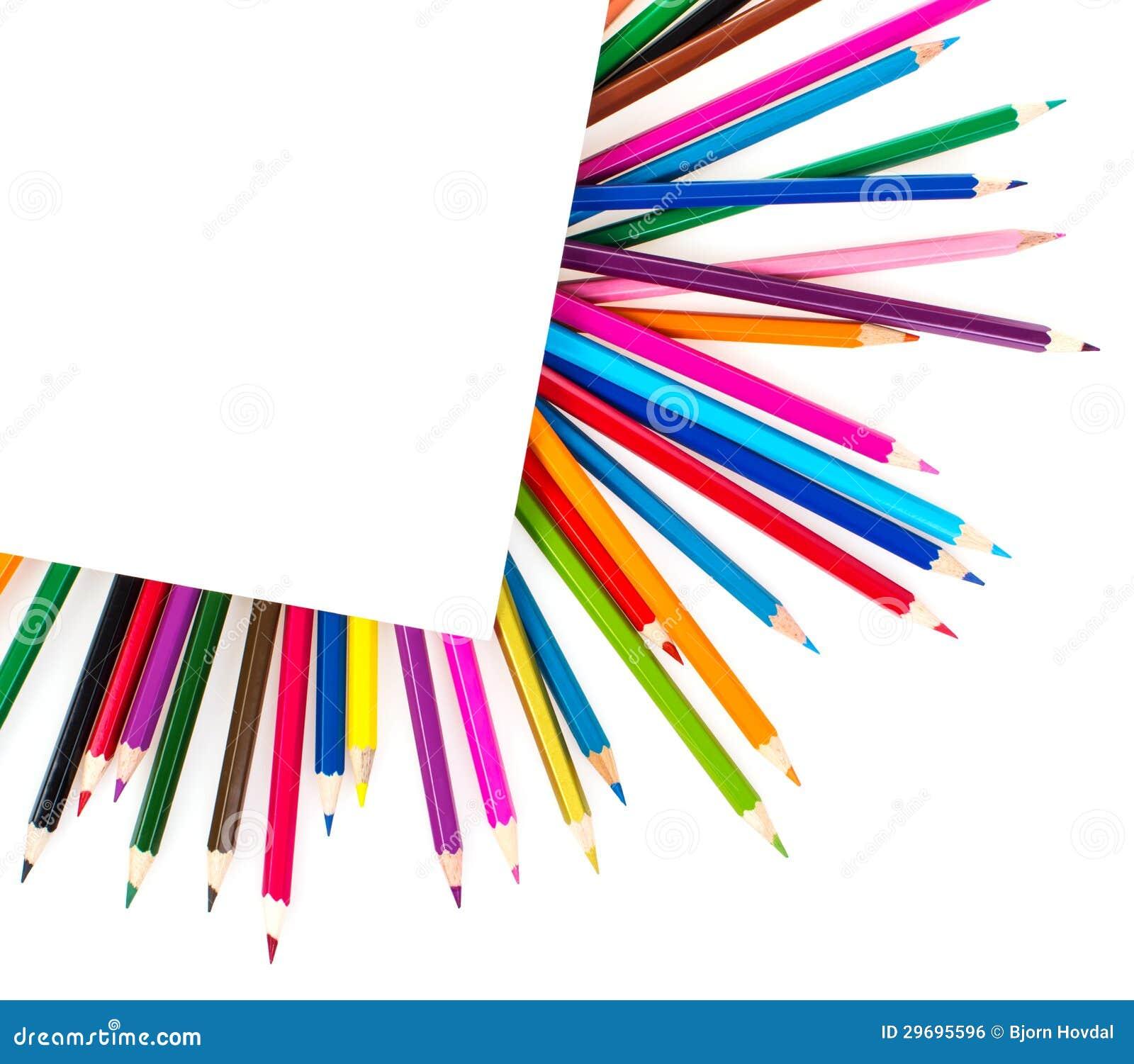Покрашенные карандаши под листом бумаги
