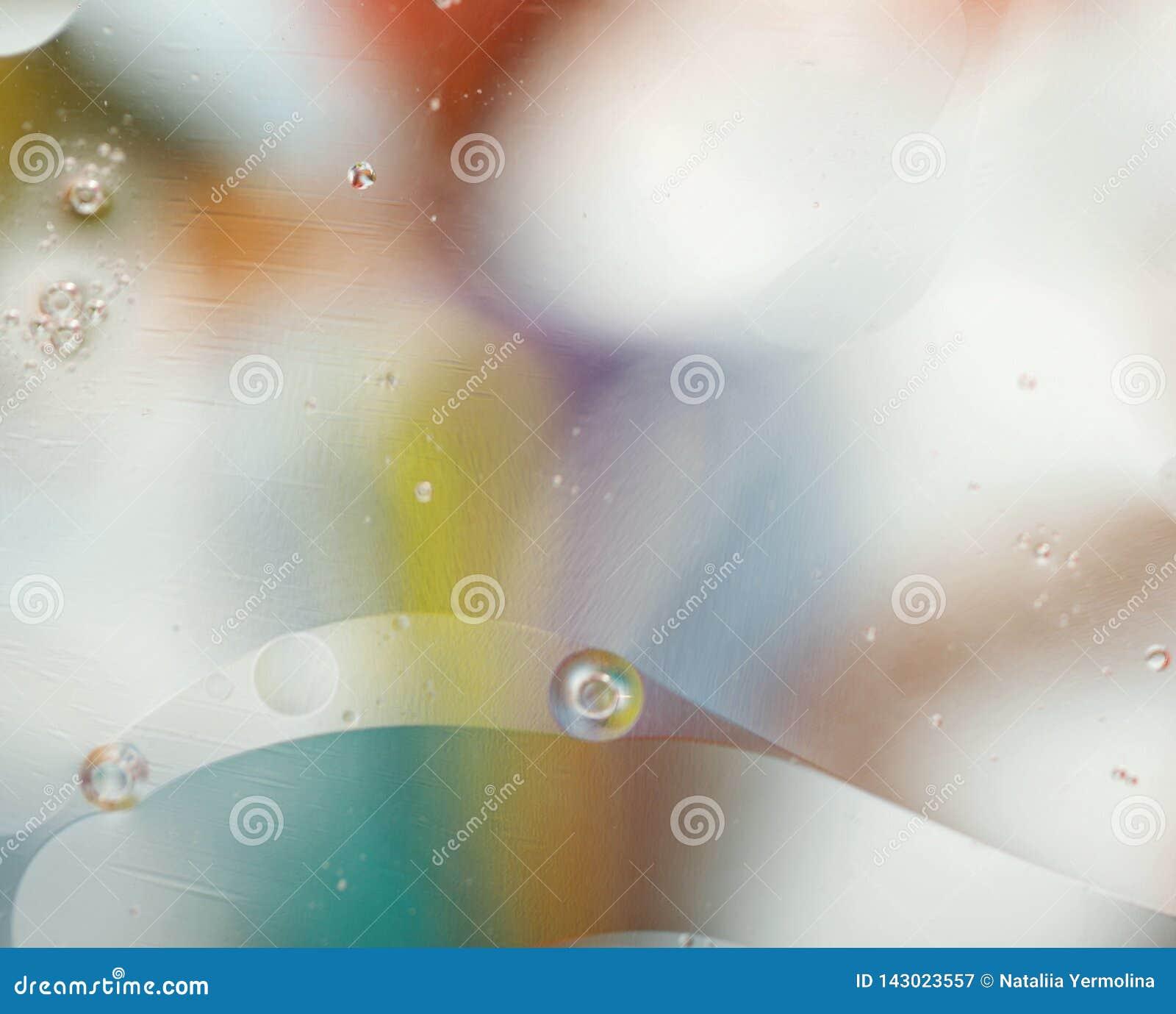 Предпосылка запачканная конспектом нежная Текстура жидкости с кругами и пузырями пастельных цветов