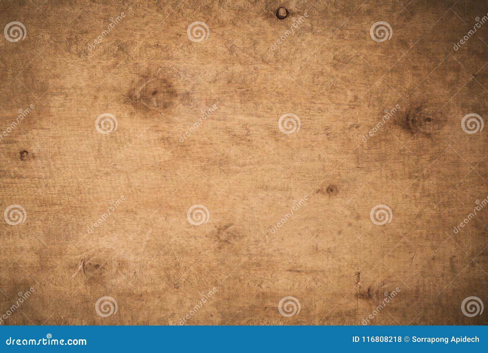 Предпосылка старого grunge темная текстурированная деревянная, поверхность ol