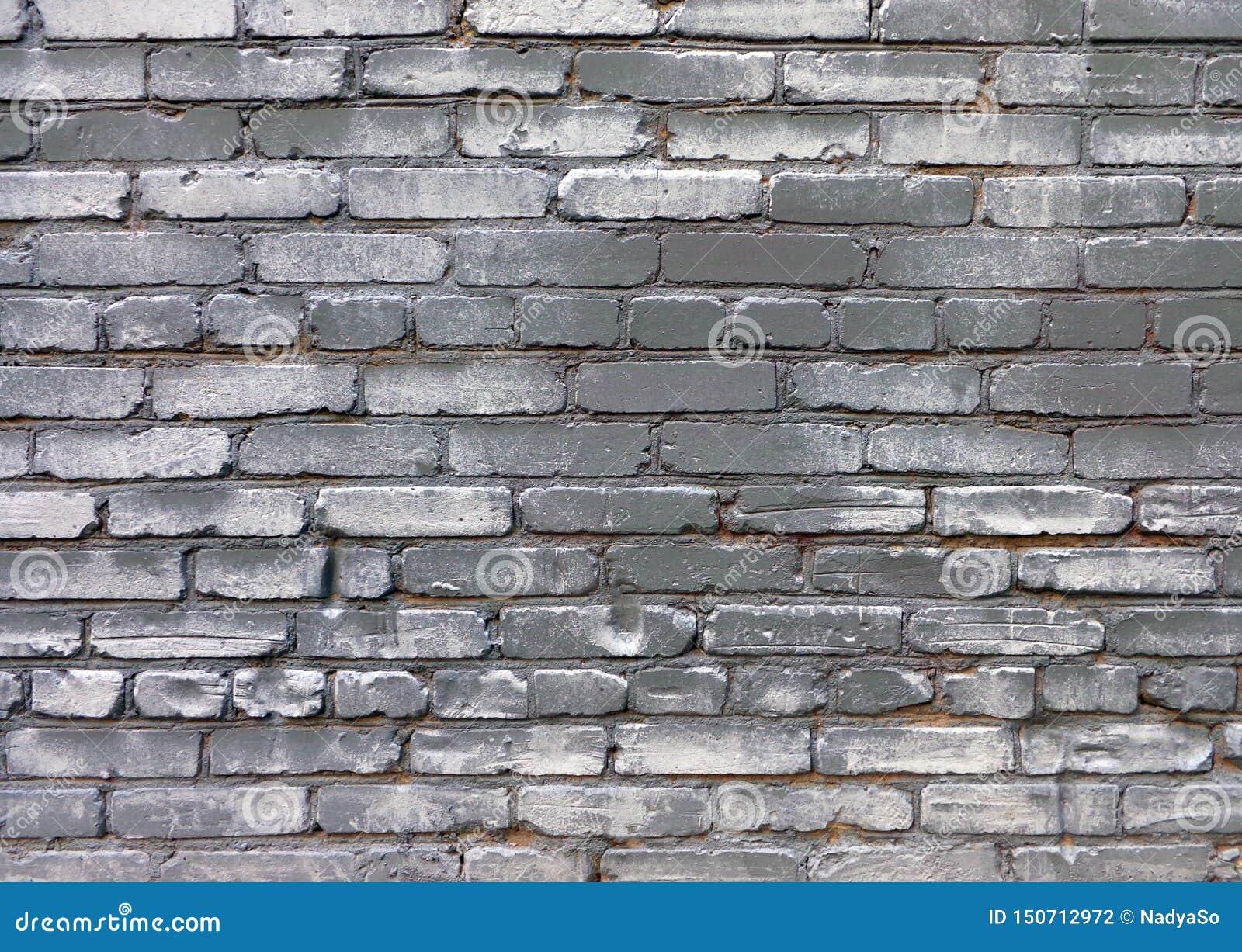 Предпосылка grunge Uurban стены старого кирпича серой покрашенной