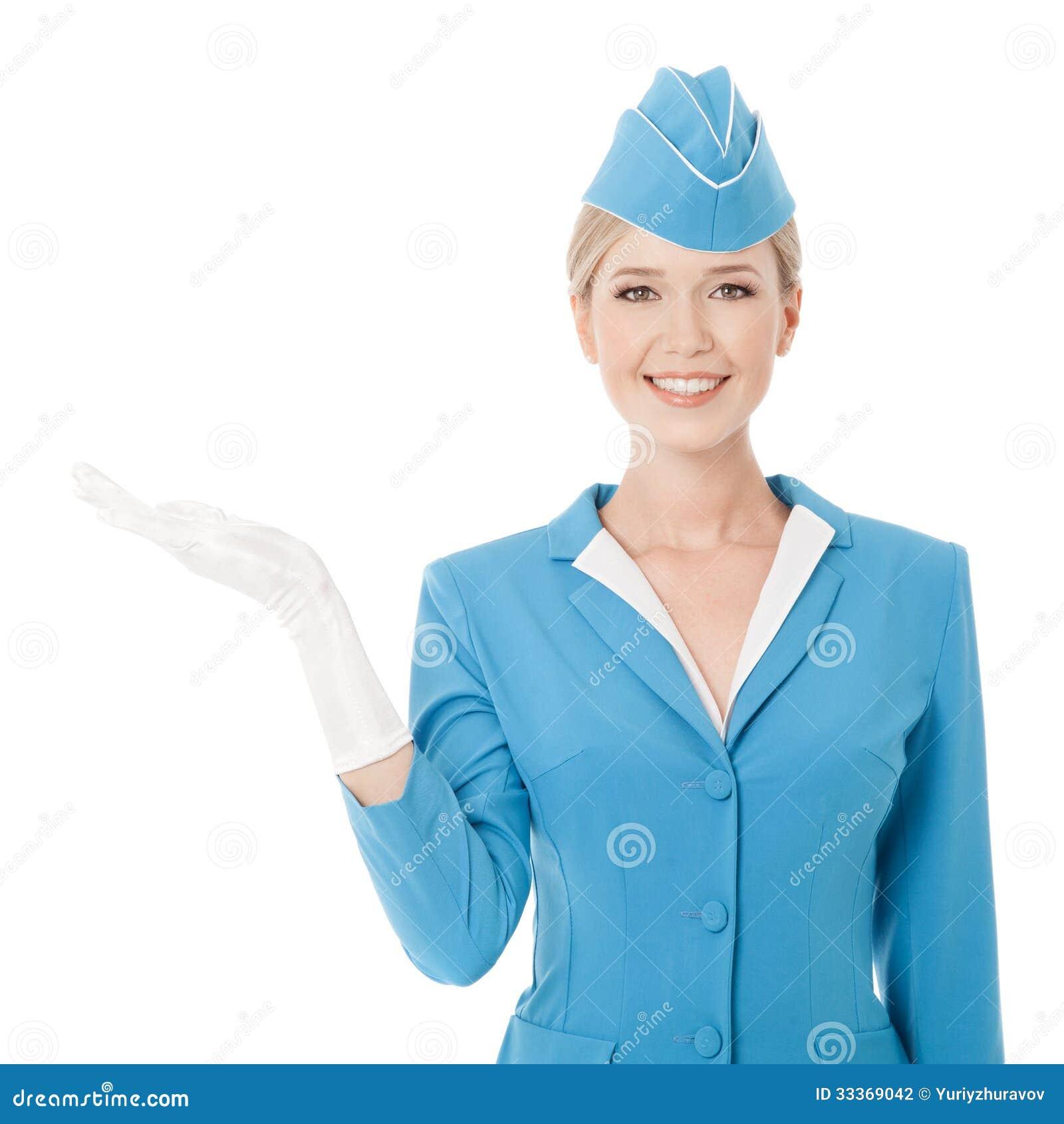 Прелестно Stewardess в голубой форме держа в руке на w