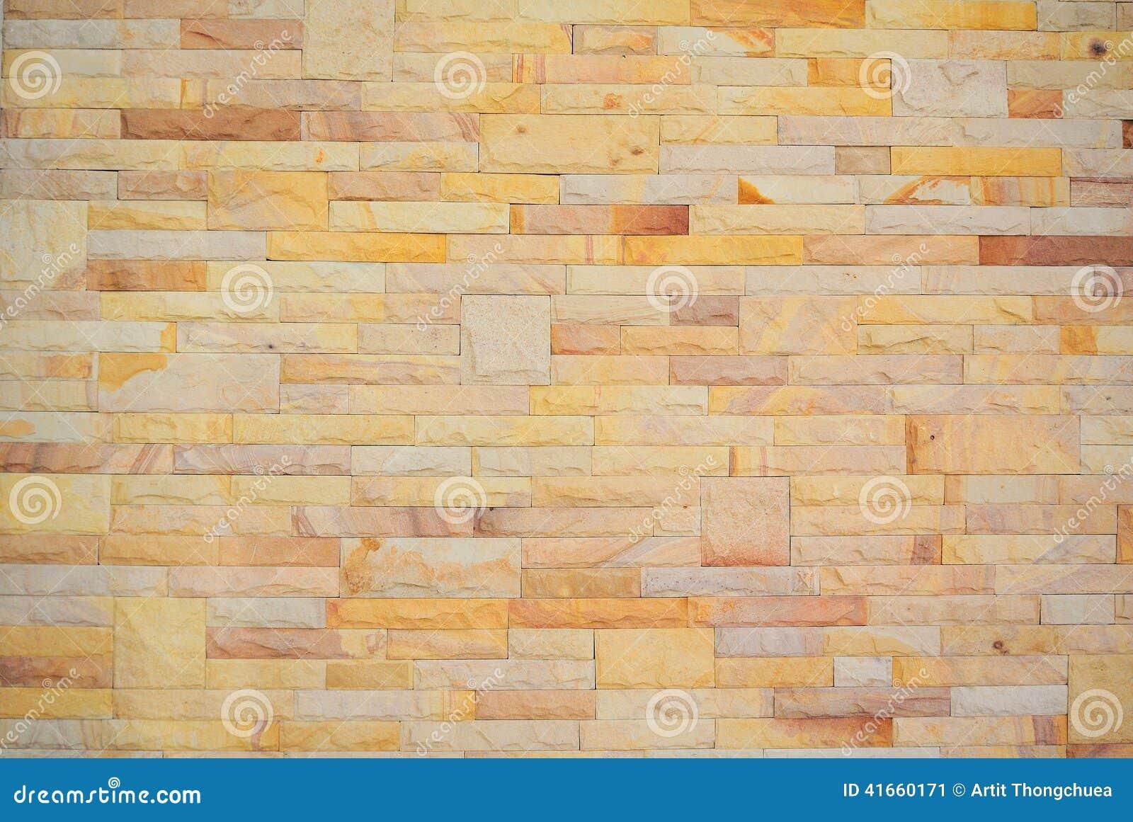 Предпосылка красочной кирпичной стены