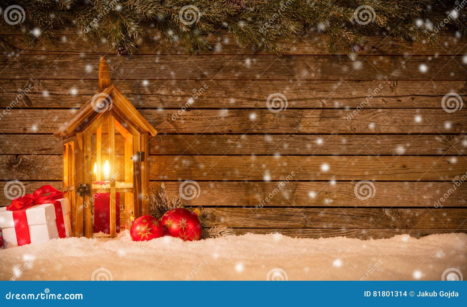 Предпосылка рождества с подарками и фонариком