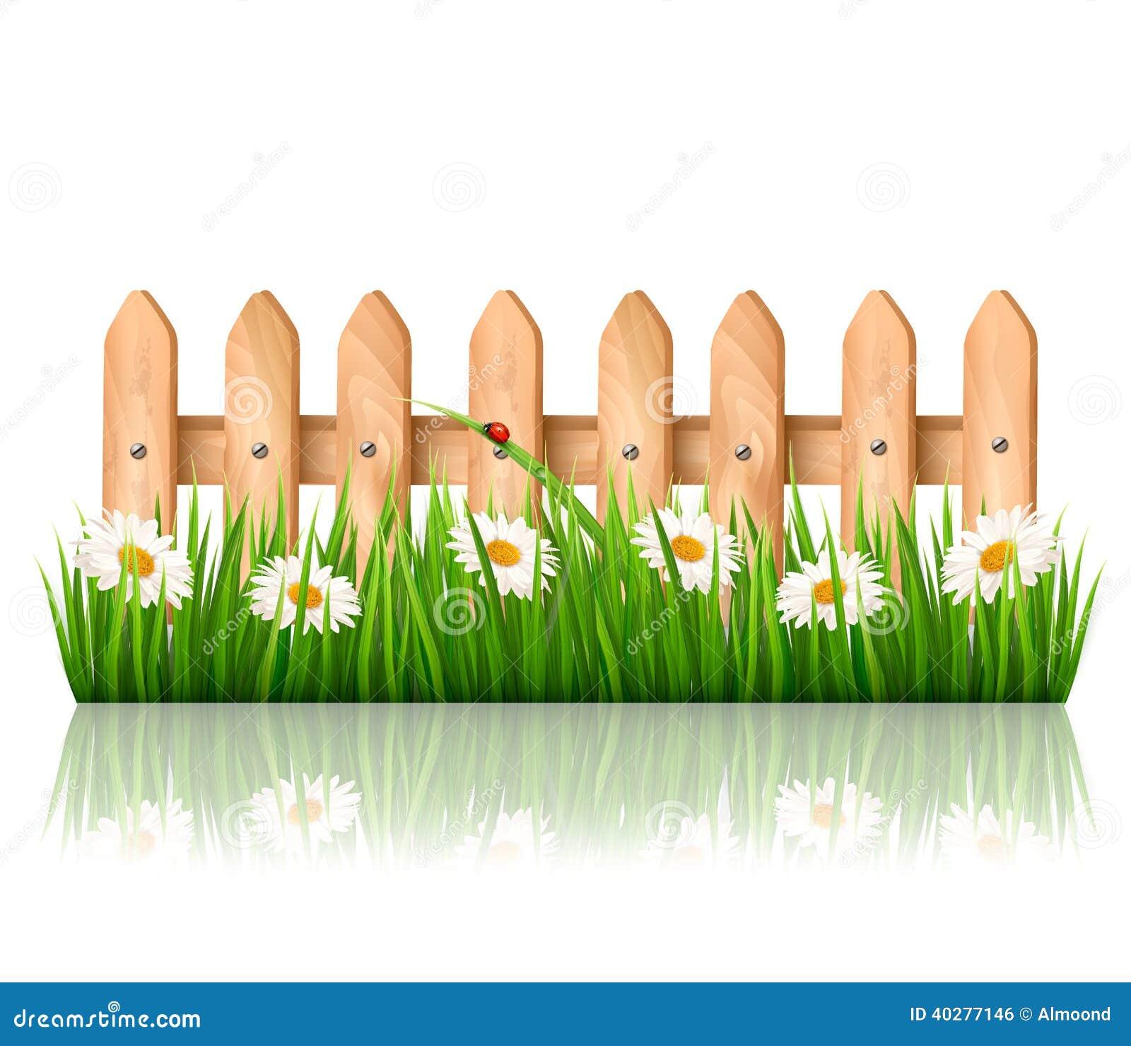 Предпосылка с деревянной загородкой с травой, цветками