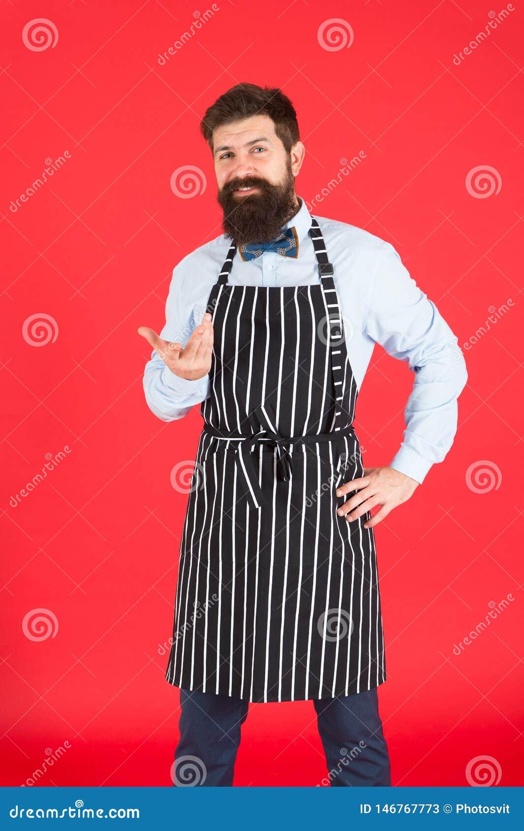 Профессионал в кухне Человек с рисбермой хипстера повара бороды Предпосылка повара шеф-повара хипстера красная Бородатый варить ш