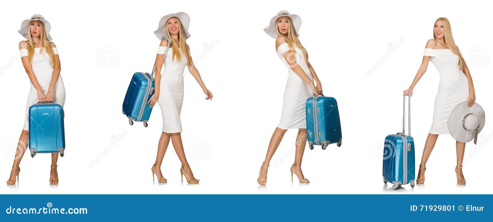Путешествуя женщина при чемодан изолированный на белизне
