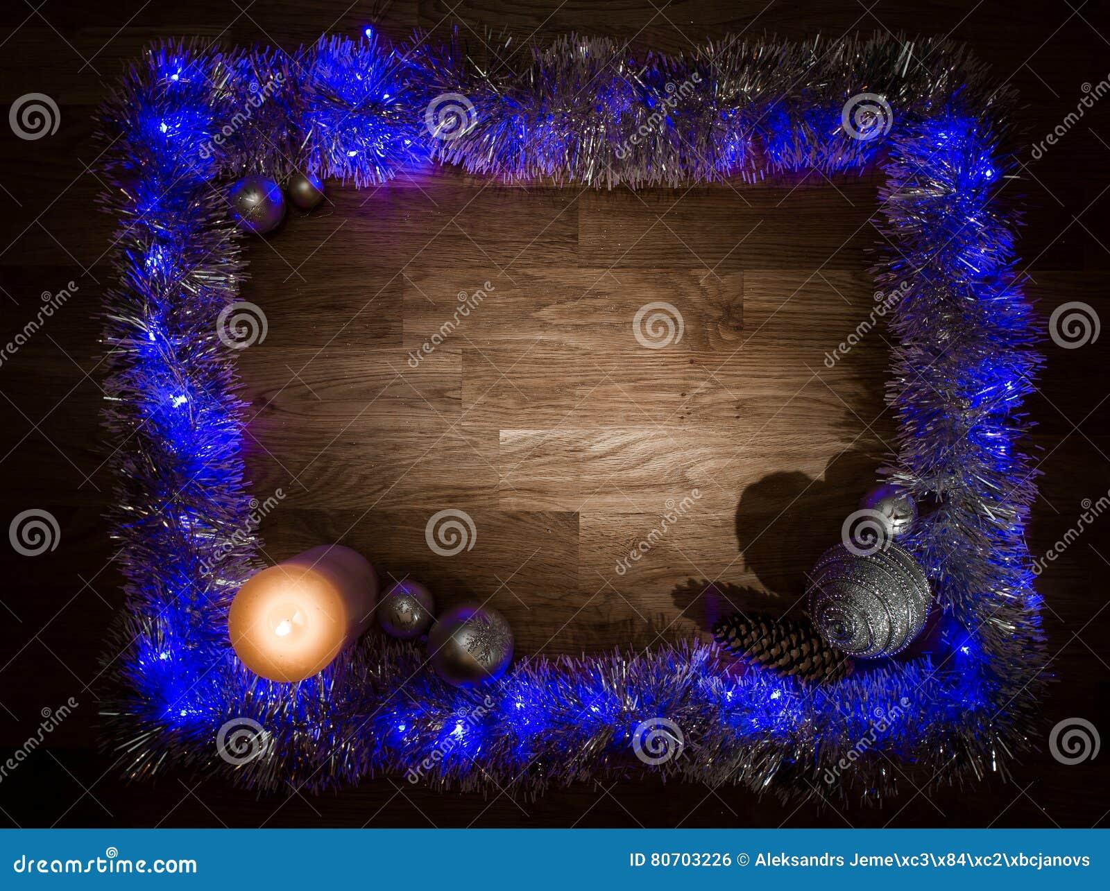 Рамка украшений рождества с светом свечи