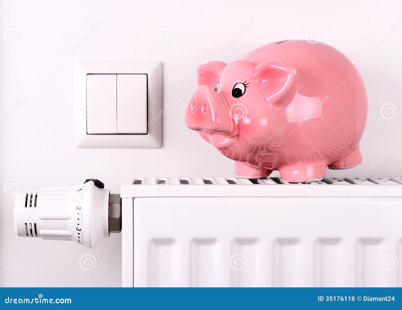 Розовая скачка копилки, сохраняя электричество и цены топления