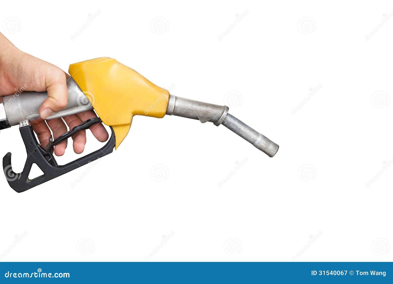 Рука держа сопло газового насоса