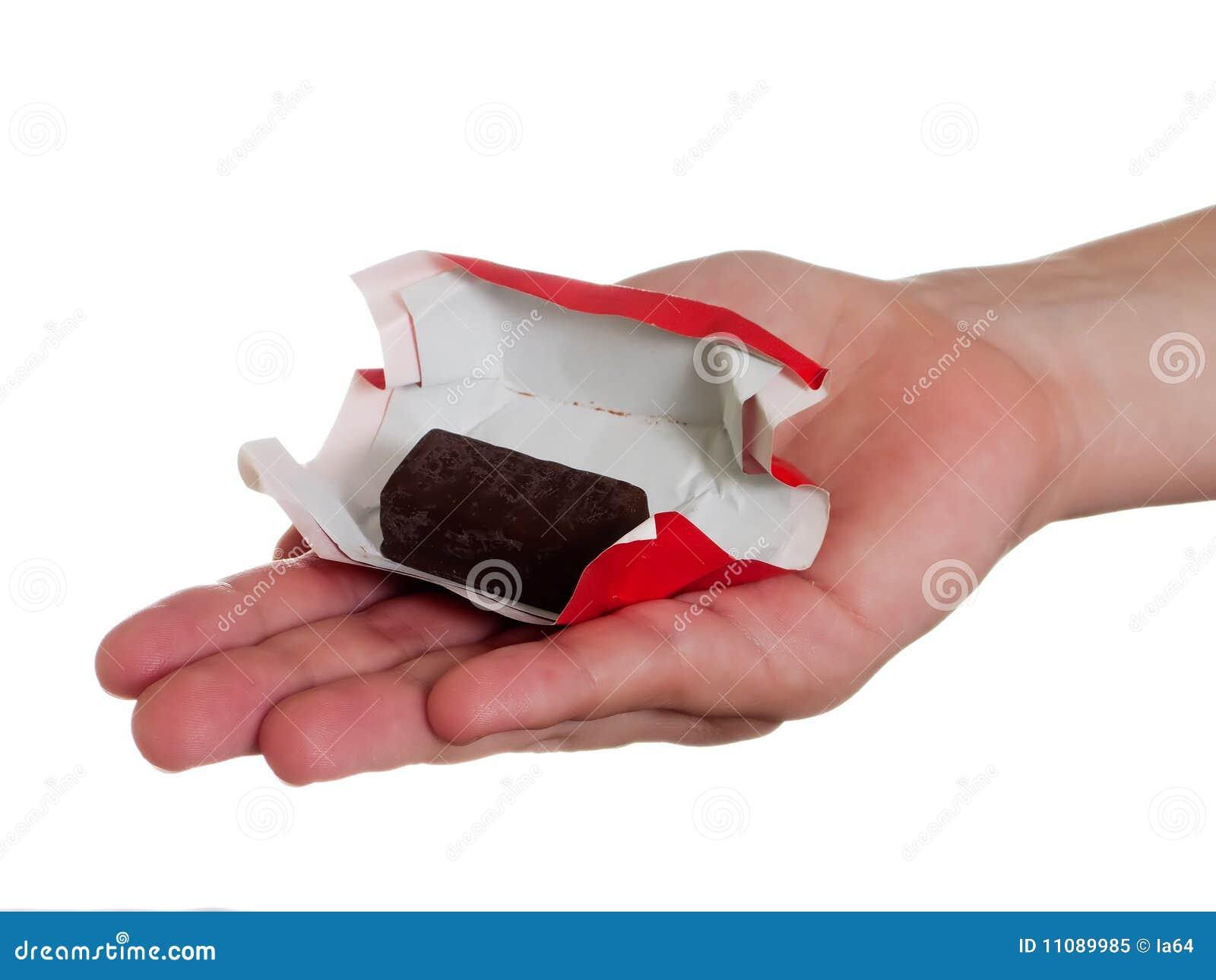 рука конфеты стоковое изображение. изображение насчитывающей конфеты -  11089985