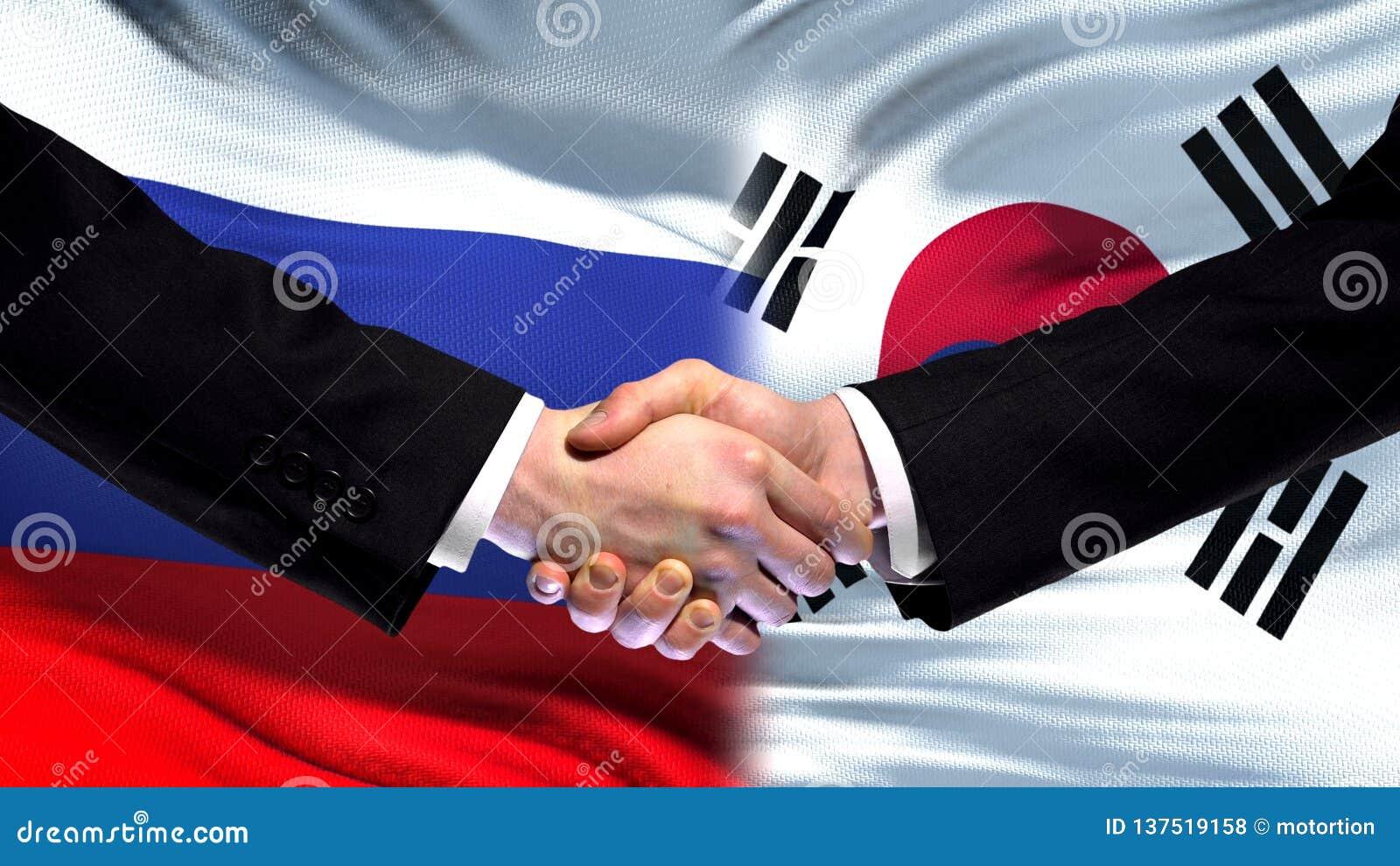 Рукопожатие России и Южной Кореи, международное приятельство, предпосылка флага