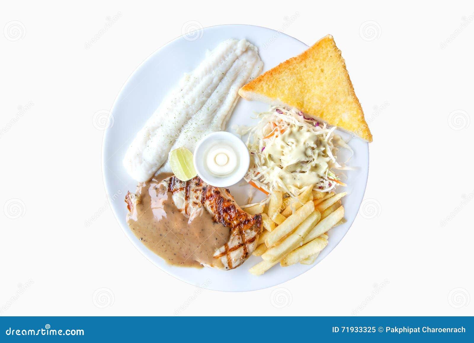 Рыбы тележки и стейк цыпленка, французские фраи, хлеб чеснока и соль
