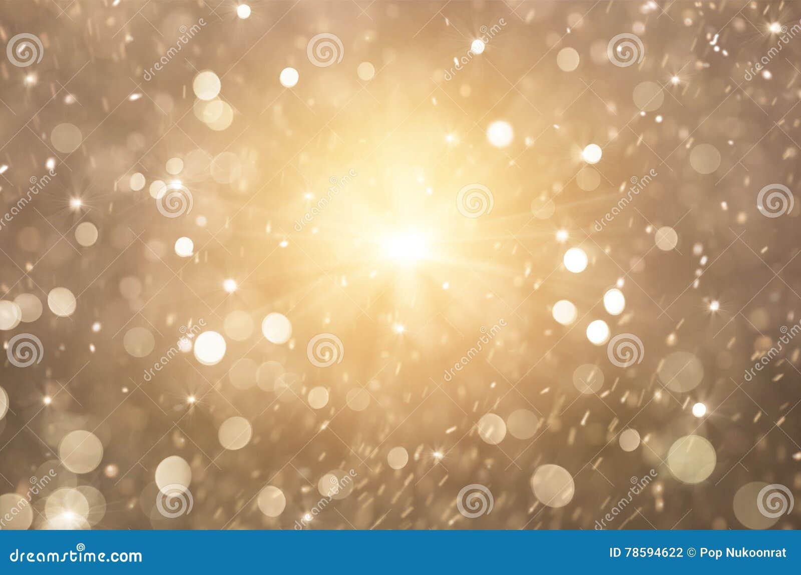 Света предпосылка яркого блеска золотые, света рождества и абстрактные моргать звезды