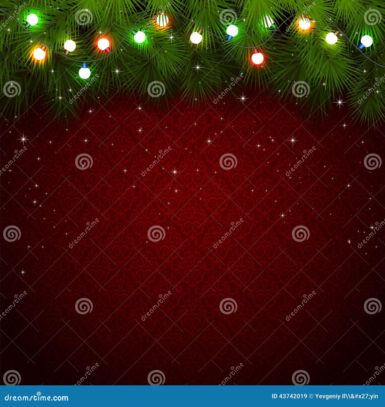 Света рождества на красной предпосылке