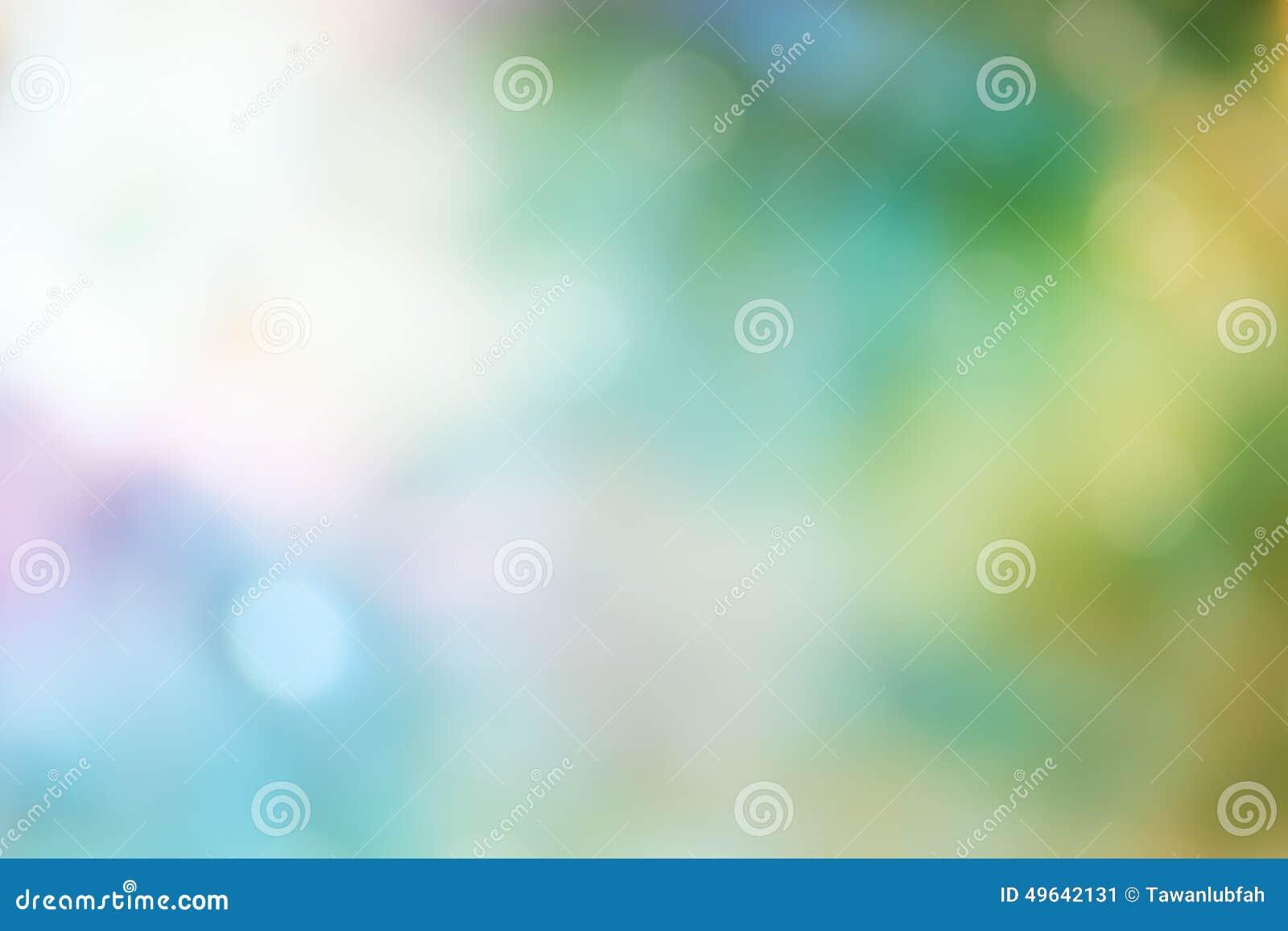 Свет Bokeh на зеленой предпосылке пастельного цвета