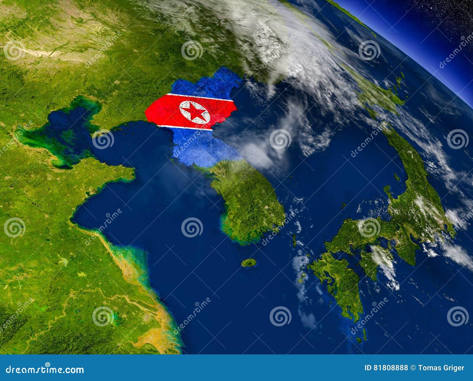 Северная Корея с врезанным флагом на земле