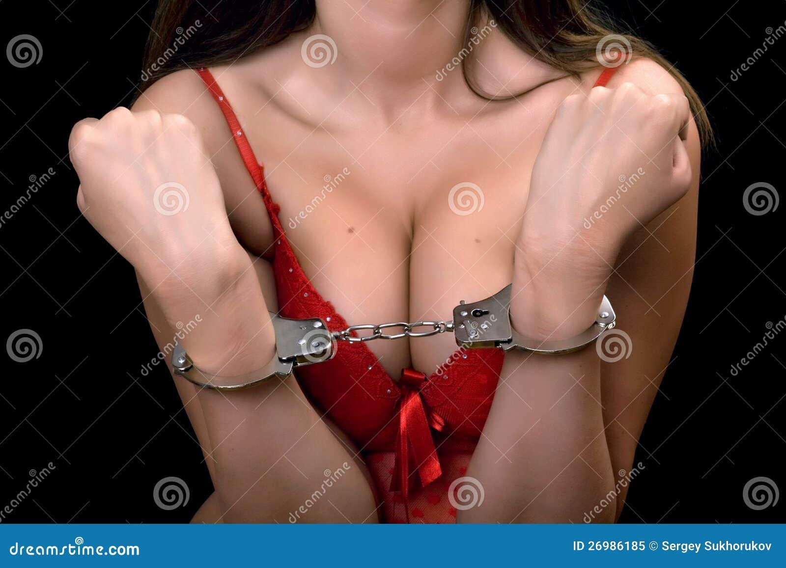 Атласе фото наручниках девушки в и