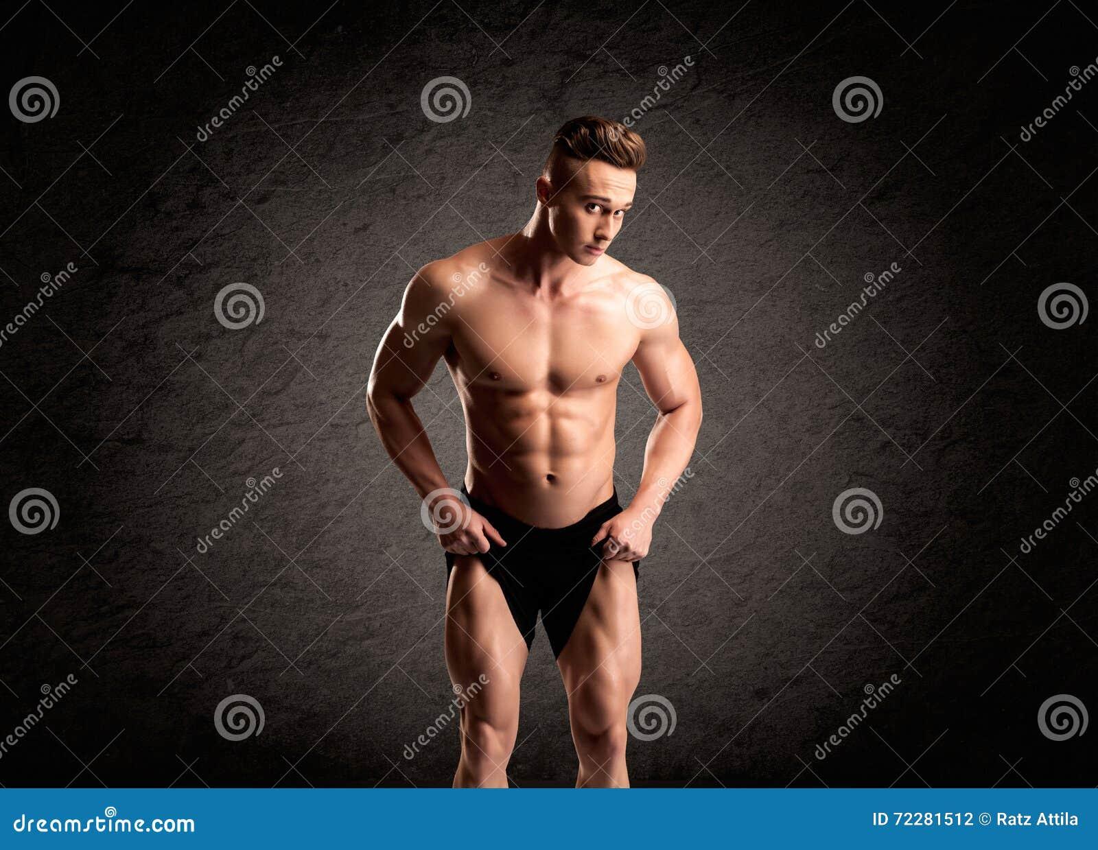 Download Сексуальный парень Lifter веса показывая мышцы Стоковое Фото - изображение насчитывающей тренировка, bodysuit: 72281512