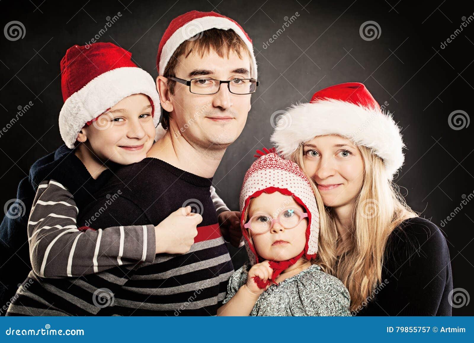 семья рождества счастливая Дети Xmas с родителями