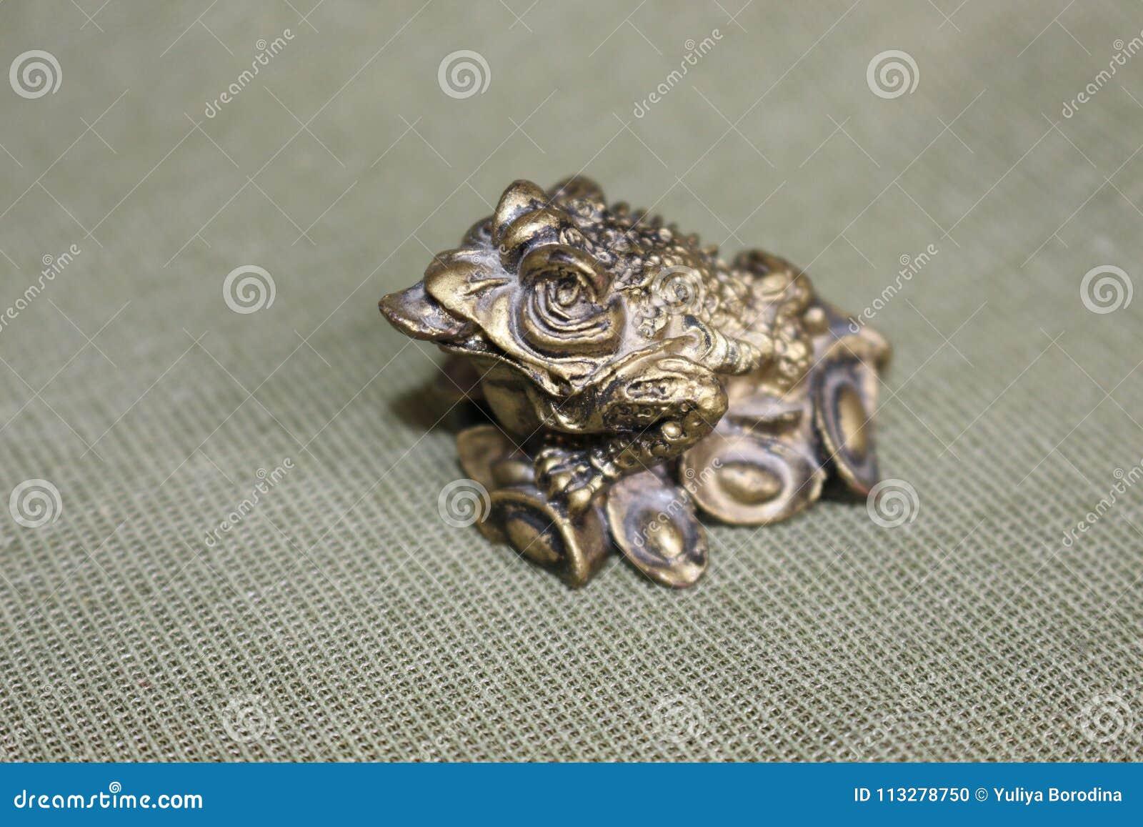 Символ лягушки, принося деньги, процветание