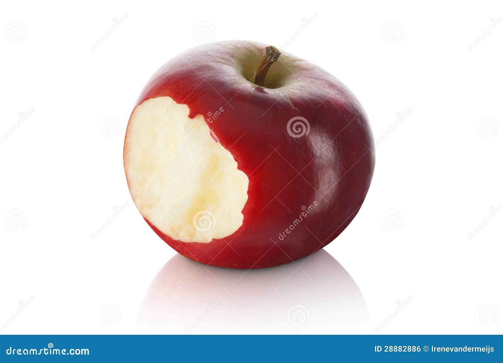 Сладостное и свежее красное яблоко при укус принятый вне