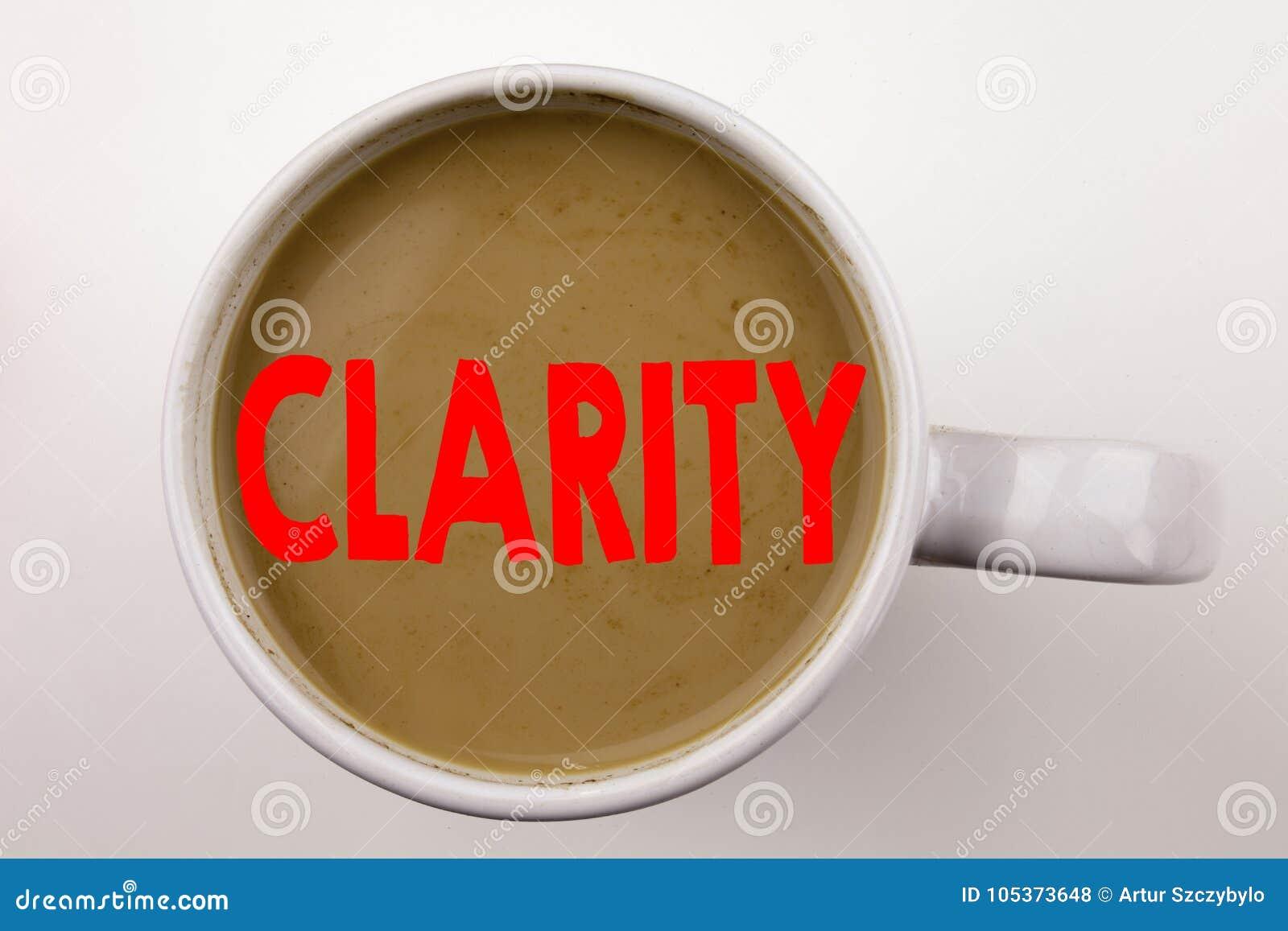 Слово, писать текст ясности в кофе в чашке Концепция дела для сообщения ясности на белой предпосылке с космосом экземпляра Черный