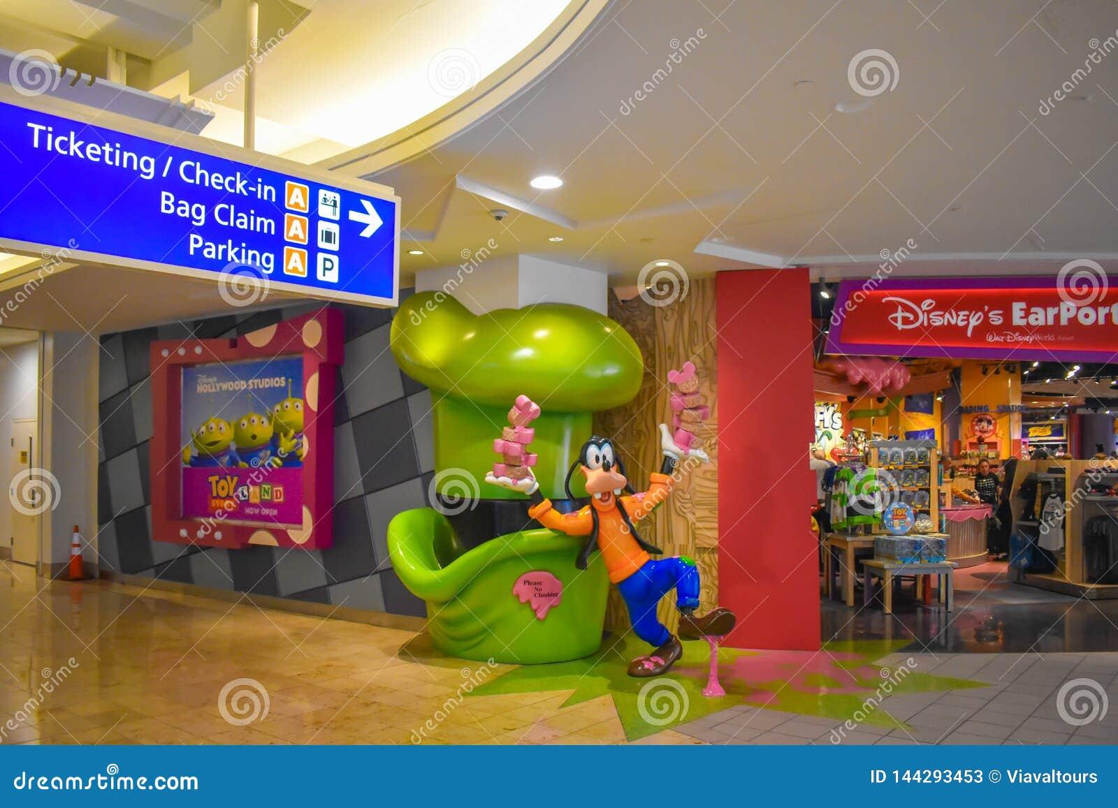 Снабжать билетами и проверить в знаке информации и чокнутый близко к магазину Дисней на международном аэропорте Орландо