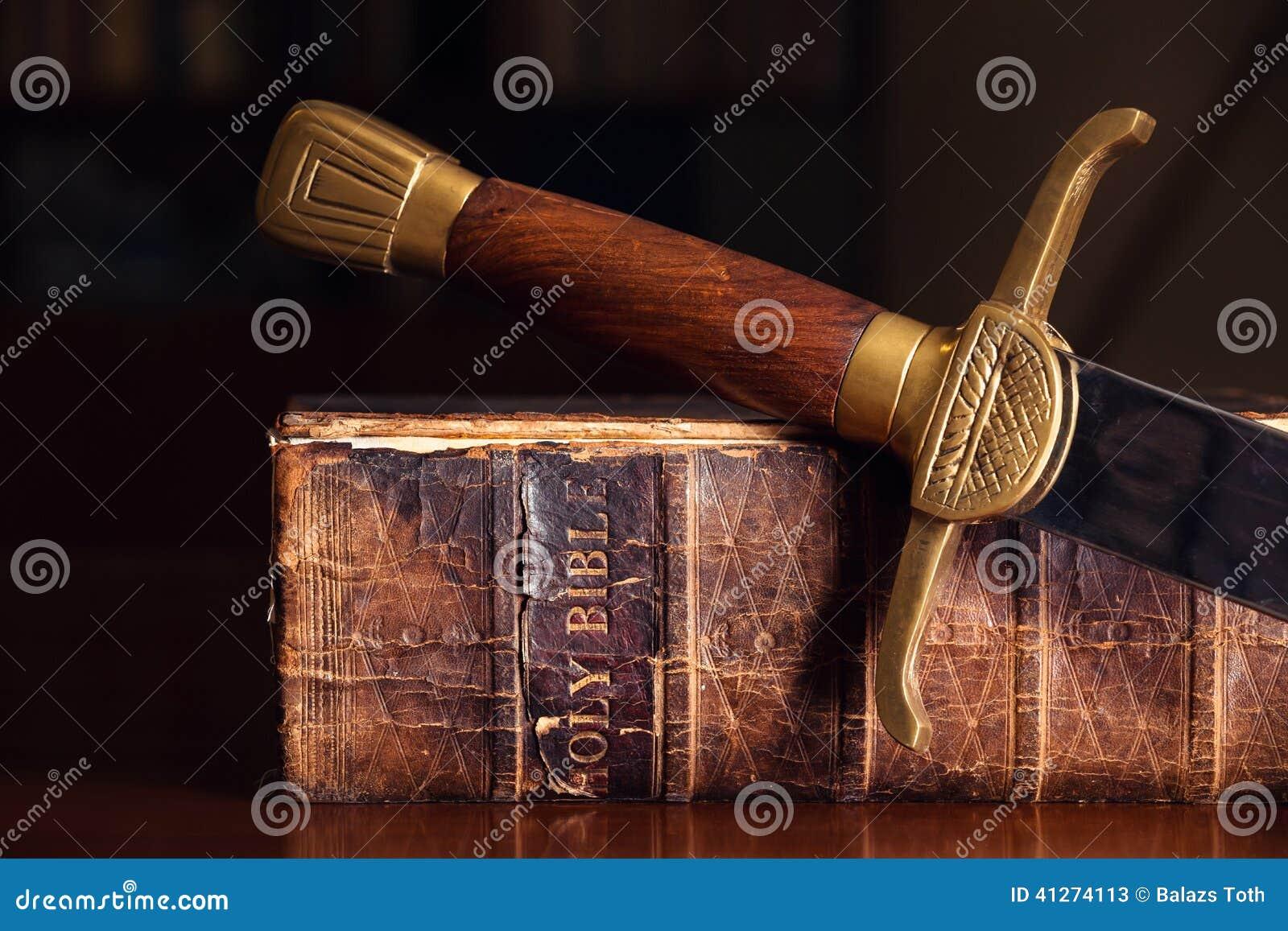 Старая библия с шпагой