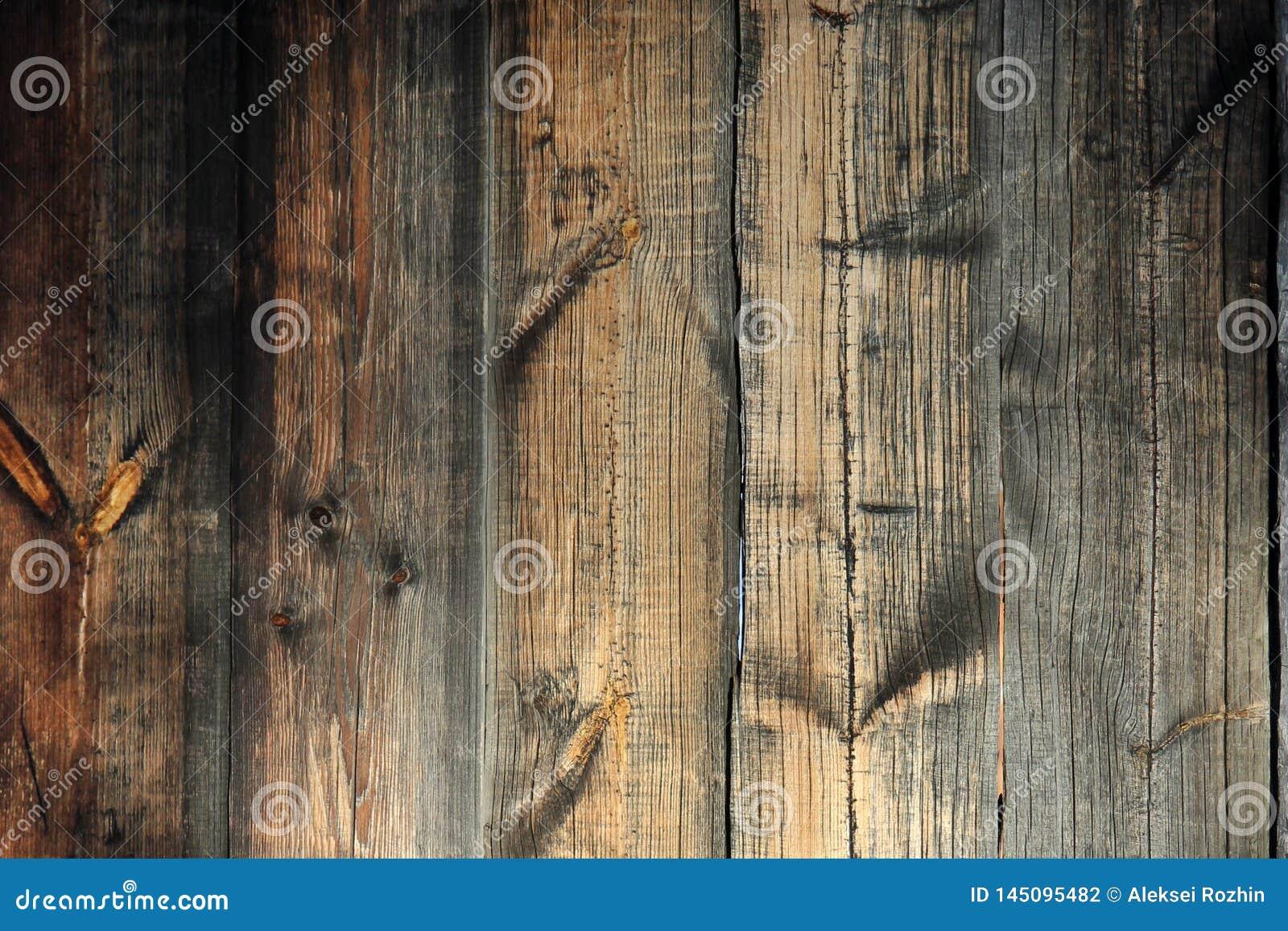 Текстура предпосылки Старая коричневая деревянная стена