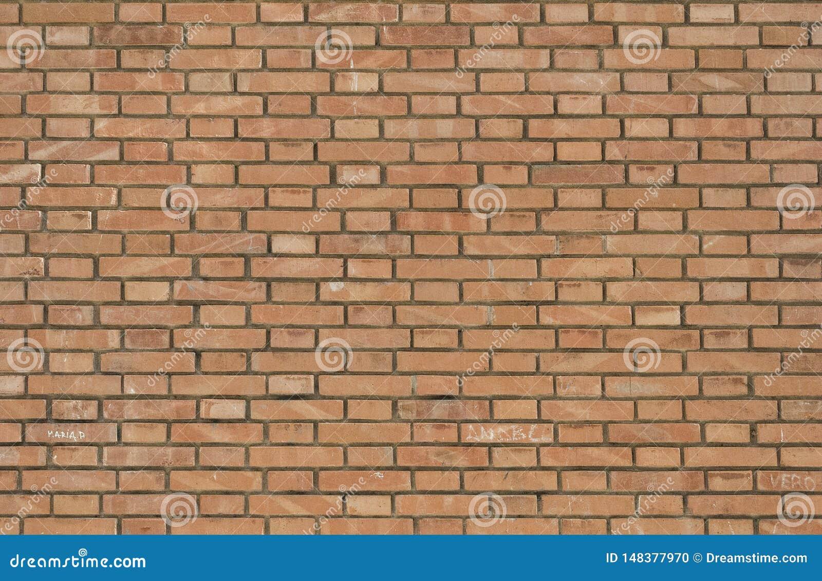 Старая красная предпосылка текстуры кирпичной стены