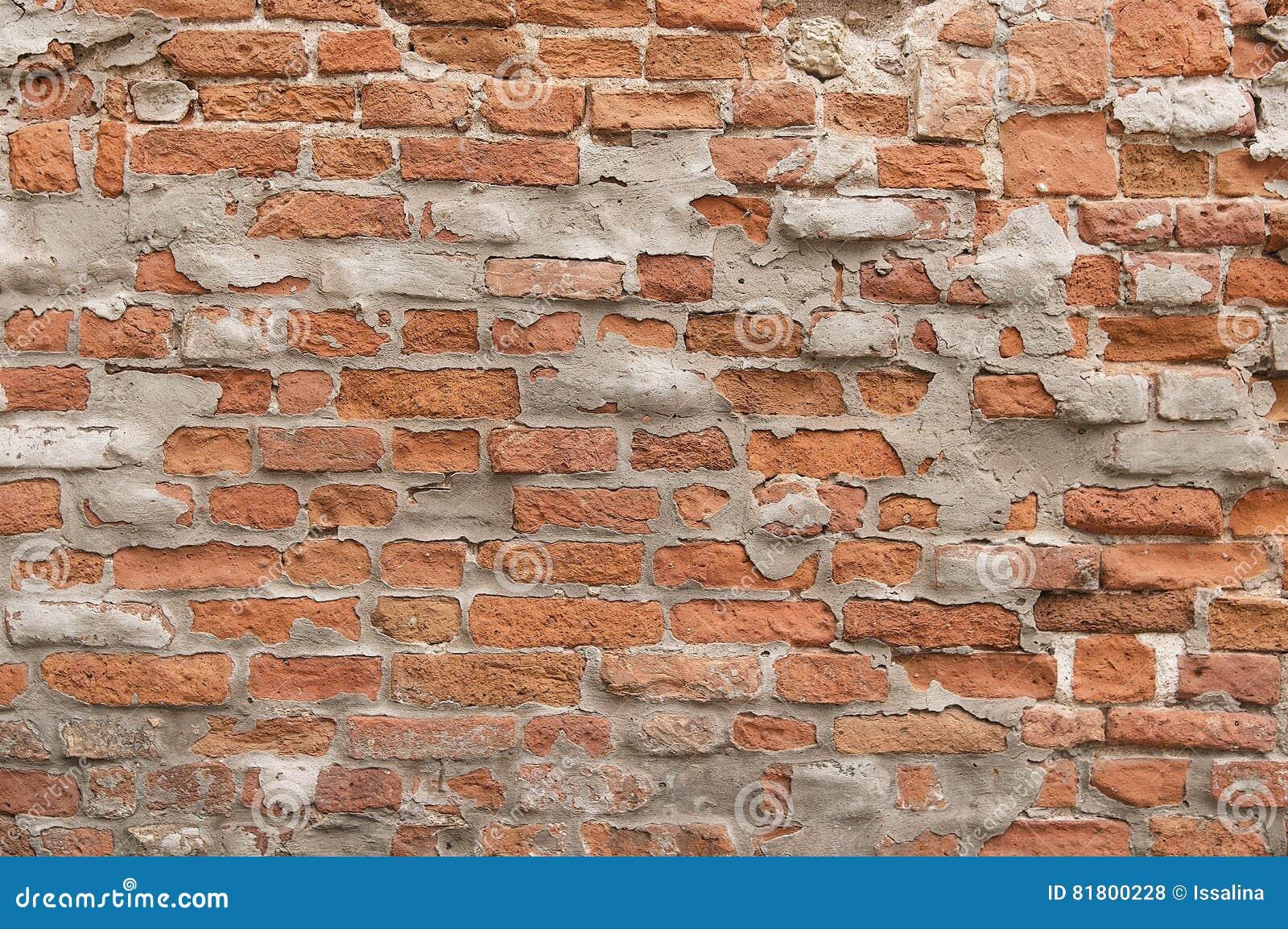 Старая покрашенная красная текстура предпосылки кирпичной стены