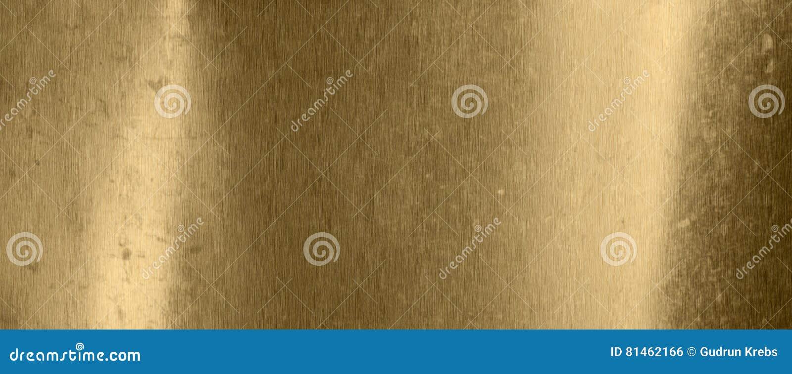 Старая предпосылка текстуры металла в золоте
