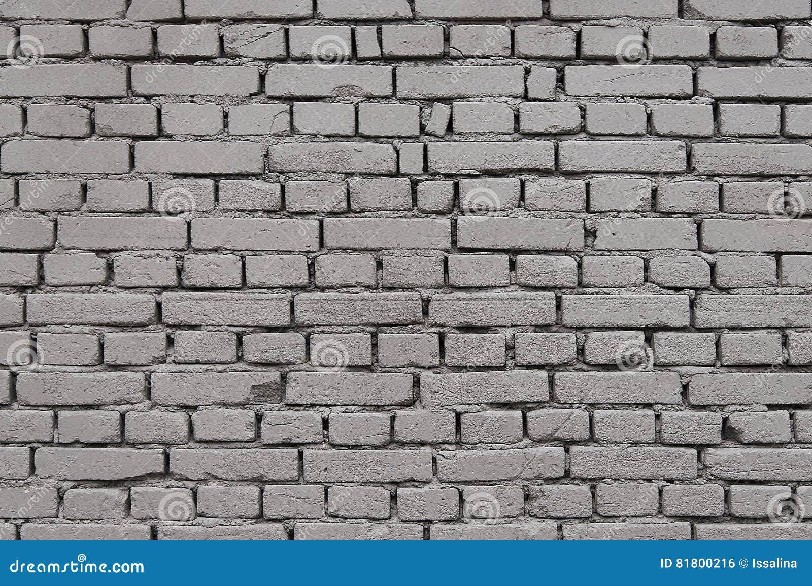 Старая серая текстура предпосылки кирпичной стены