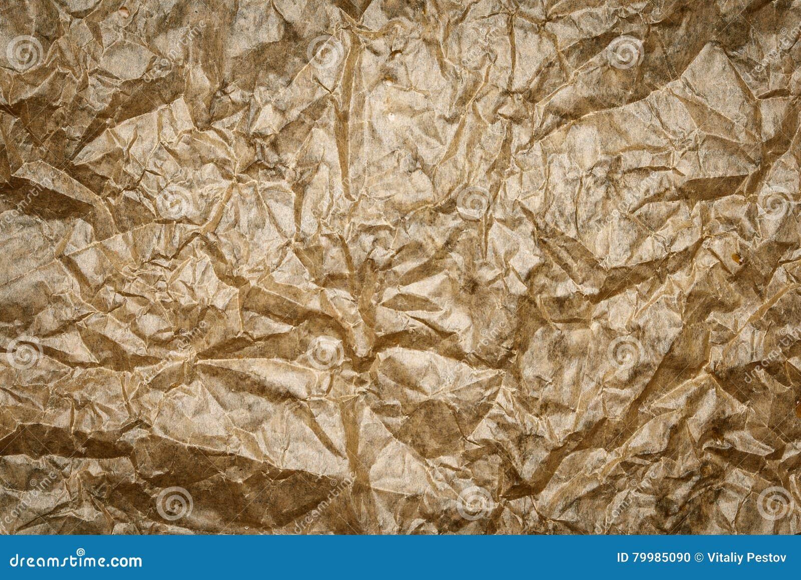 Старая скомканная текстура пергамента Бежевая бумажная предпосылка листа, морщинка, сгорела