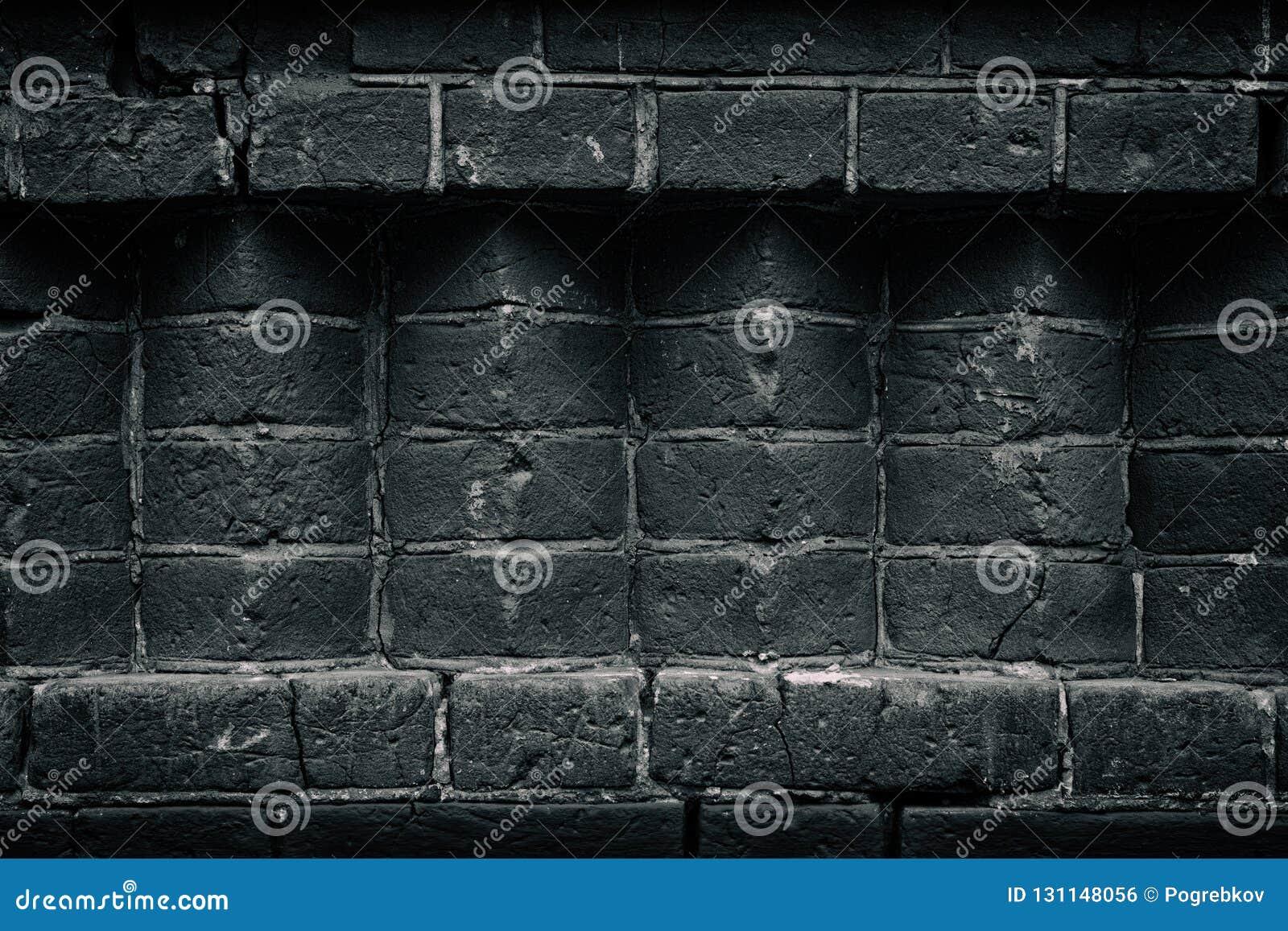 Старая черная кирпичная кладка - углы кирпича - темная - серая предпосылка