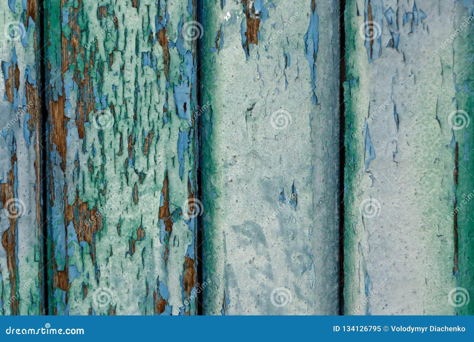 Старые деревянные доски покрашенные с несколькими слоев голубых и зеленых красок