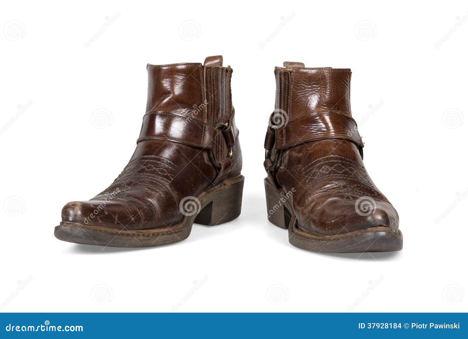 Старые и worn ботинки ковбоя
