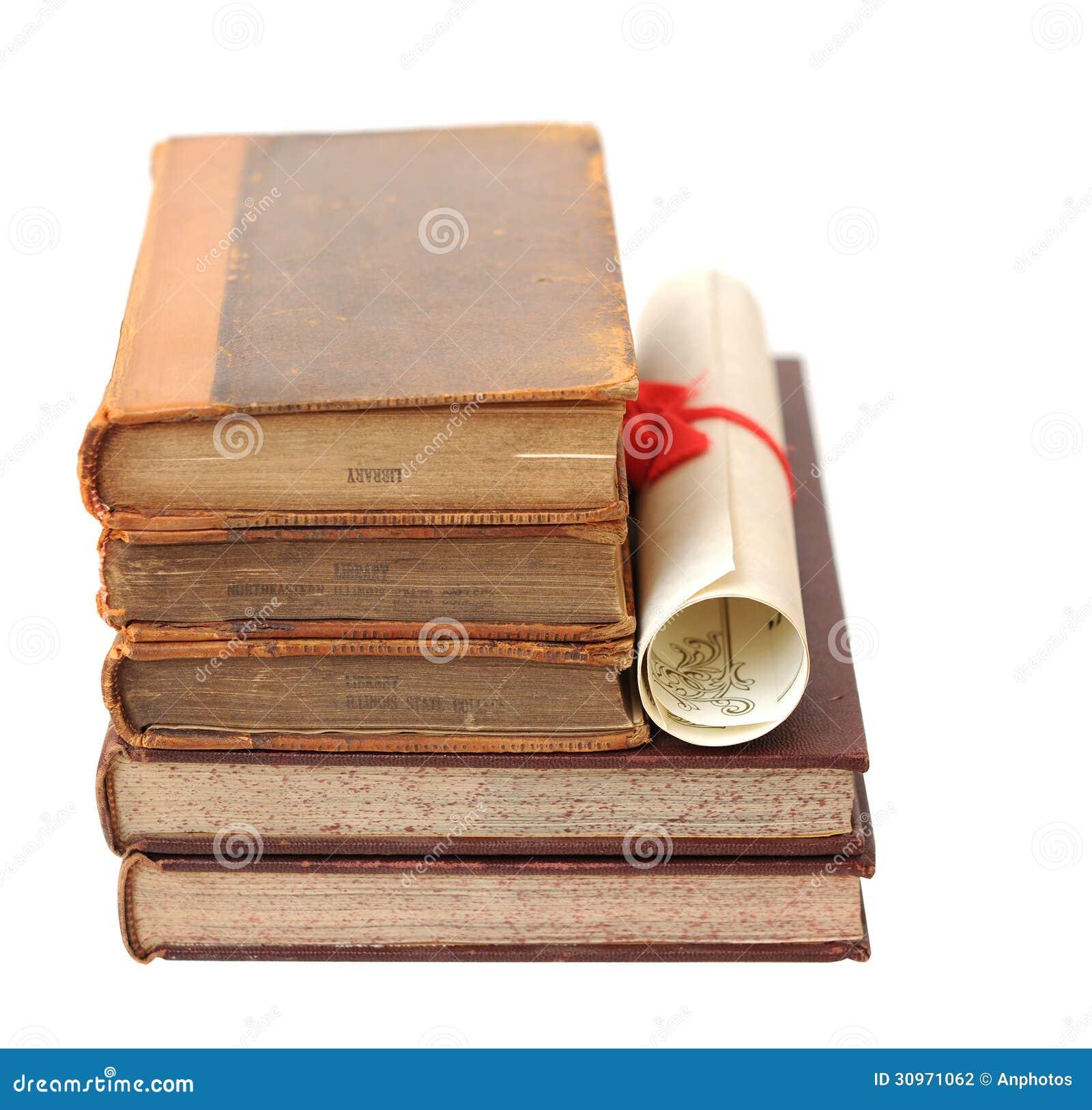 Старые книги и диплом стоковое фото изображение насчитывающей  Старые книги и диплом