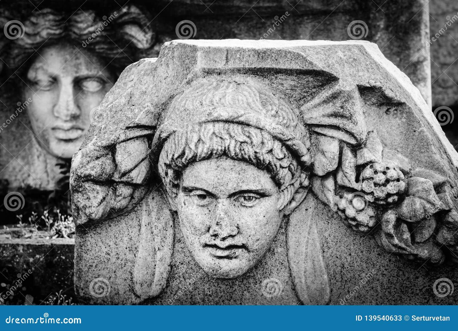 Старый сброс маски древнего города Afrodisias Aphrodisias в Caria, Karacasu, Aydin, Турции