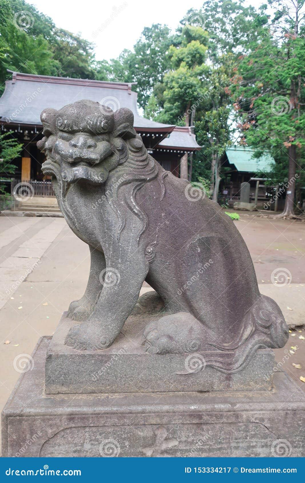 Статуя Komainu