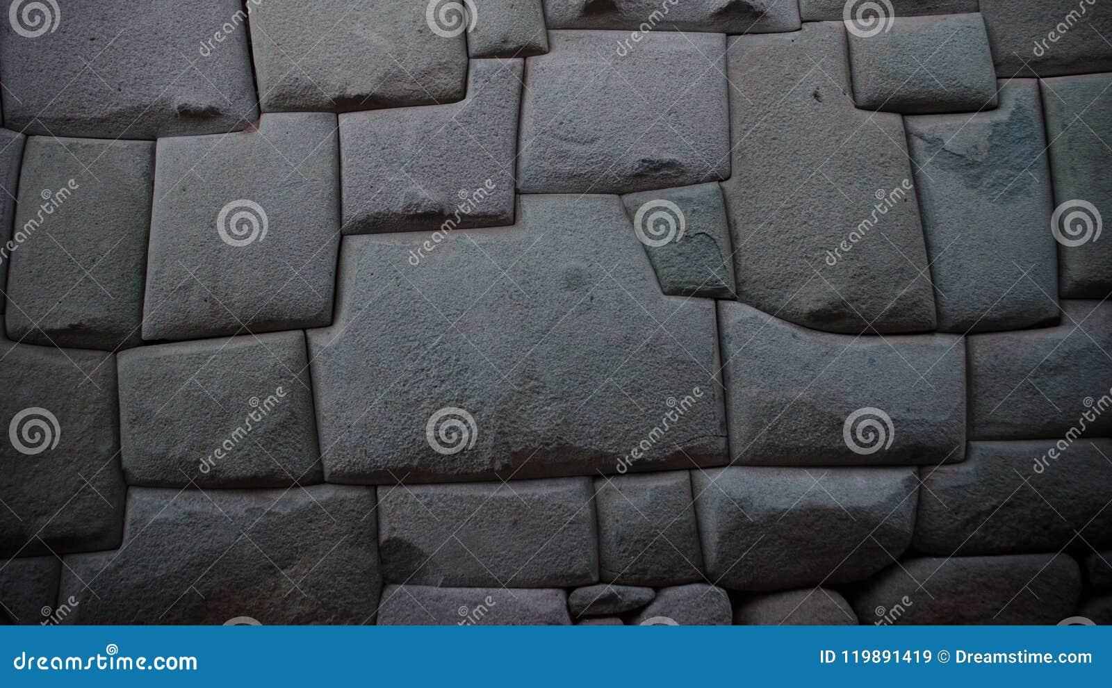 Стена старого inca каменная в городе Cusco, Перу