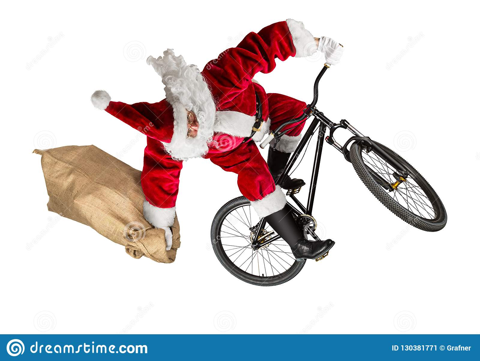 Сумасшедший Санта Клаус скачет на горный велосипед грязи с ба мешковины джута