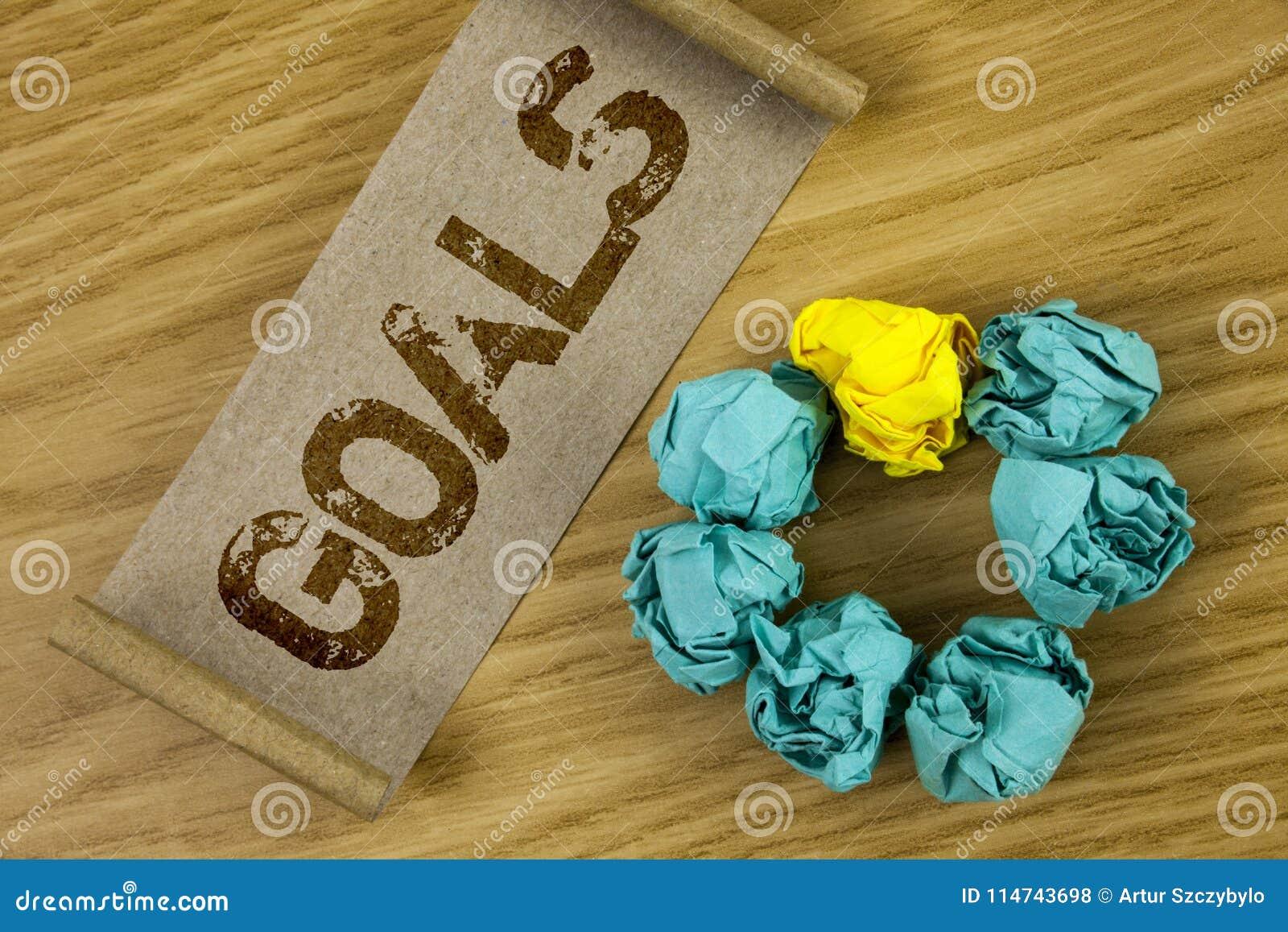 Схематическое сочинительство руки показывая цели Фото дела showcasing пожеланные достижения целится чего вы хотите выполнить в f