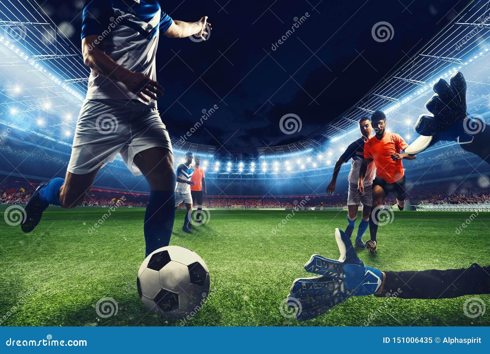 Сцена футбола с состязаясь футболистами на стадионе