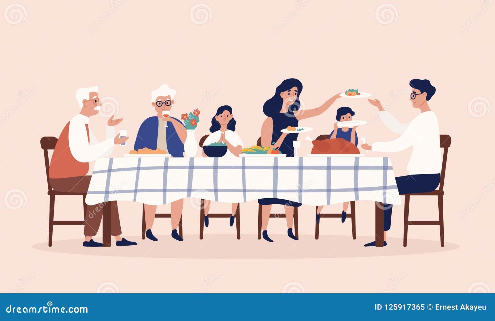 Счастливые люди сидя на таблице, ел еды праздника, выпивая вино и говорить друг к другу Рождество семьи или