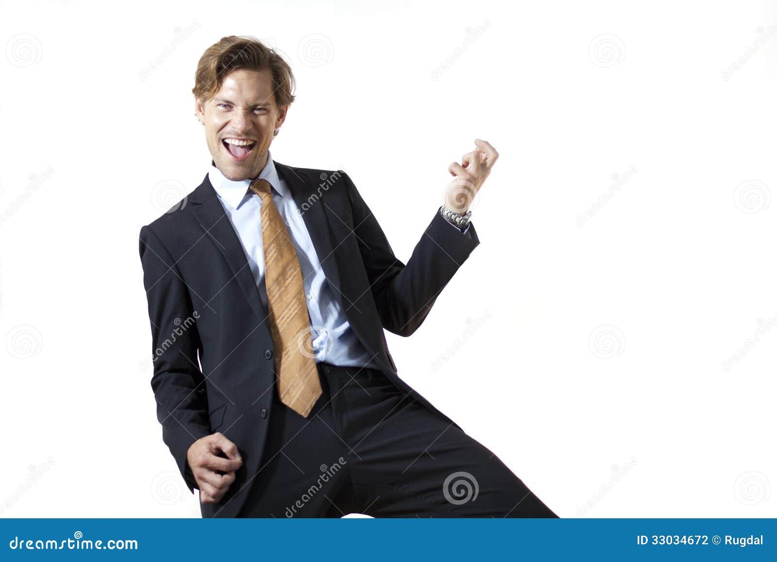Счастливый бизнесмен тряся его