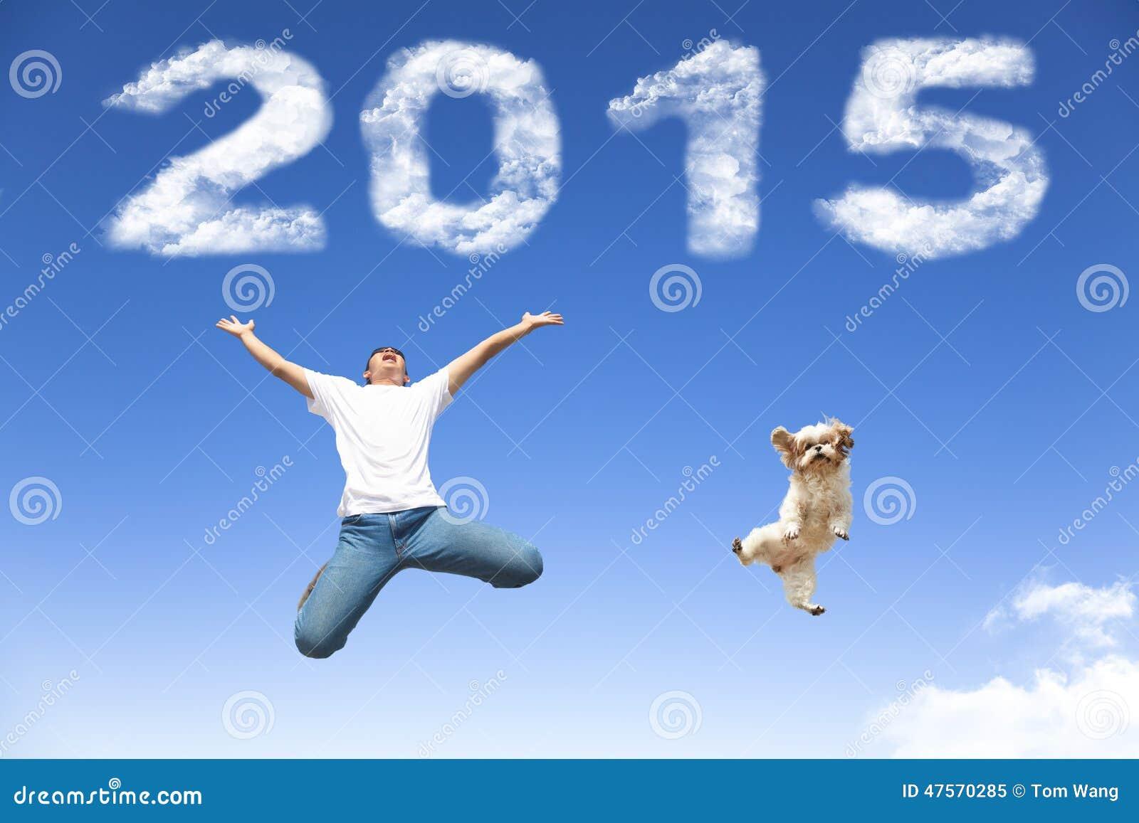 Счастливый Новый Год 2015 скакать молодого человека и собаки